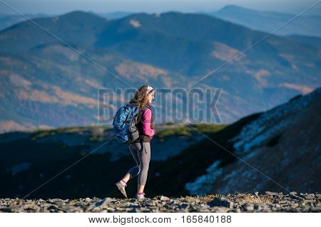 Young Happy Woman Hiker Is Walking On Mountain Plato