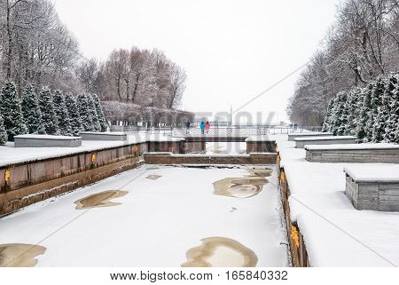 PETERHOF, SAINT - PETERSBURG, RUSSIA - JANUARY 15, 2017: People take pictures on the bridge over the canal, provides to The Grand Cascade in The Lower Park in The State Museum Preserve Peterhof
