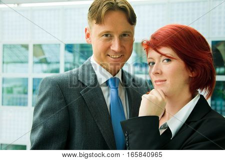 business people in front of an office building