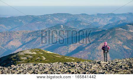 Female Hiker Enjoying Beautiful Overlook On The Mountains