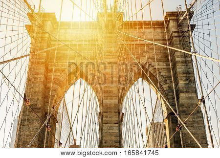 Close up on Brooklyn Bridge in the sunset New York