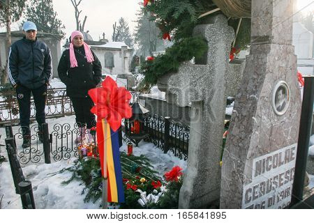 Bucharest Romania December 25 2009: People are praying at the grave of Romania's late communist dictator Nicolae Ceausescu during commemoration of his death. Year after year Romania's nostalgic Communists gather to mourn Ceausescu who was executed on Chri