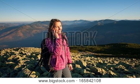 Portrait Of Young Cute Female Backpacker Talking Cell Phone