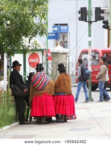 La Paz Bolivia - December 12 2016: Group of people in traditional dress and bowler hats in La Paz Bolivia on December 12 2016