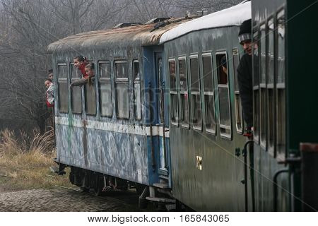 Brad Romania December12 2009: Tourists are travel in an old steamed cog train in Brad on winter holydays.