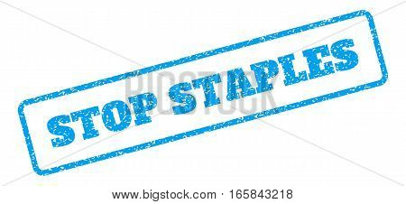 Blue rubber seal stamp with Stop Staples text. Vector tag inside rounded rectangular shape. Grunge design and dirty texture for watermark labels. Inclined sign on a white background.