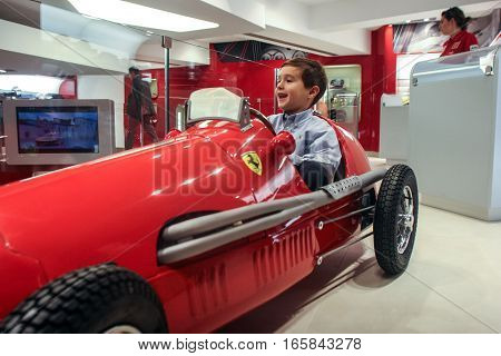 Bucharest Romania December 5 2009: A child is playing in a car at the opening of the Ferrari showroom in Bucharest.