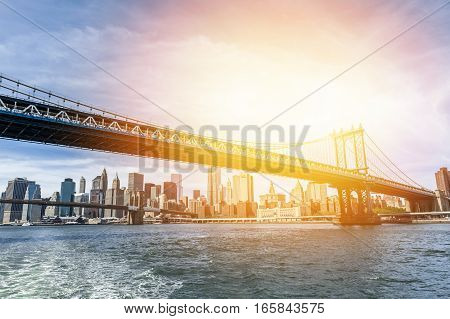 The Manhattan skyline and Manhattan Bridge at sunset New York.