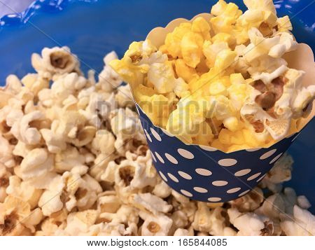 Cute polka dot cup of popcorn for National Popcorn Day or fun party health snack or date night