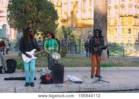ROME, ITALY: December 31, 2016 : ethnic musicians sing and play on a street in Rome on December 31, 2016, Rome, Italy