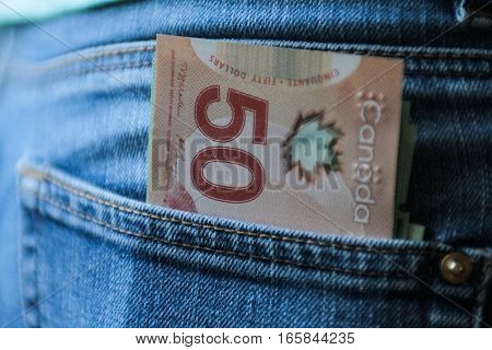 Bucharest Romania December 2 2015: Canadian currency in a blue jeans pocket.