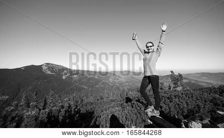 Young Happy Female Hiker At The Mountain Top