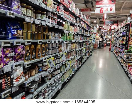 Bucharest Romania December 24 2015: Supermarket food shopping products aisle / isle empty.