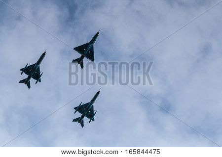 BUCHAREST ROMANIA DECEMBER 1 2015: Military airplanes are flying for the National Day of Romania military parade in Bucharest. More than 3000 soldiers and personnel from security agencies take part in the massive parades on National Day of Romania.