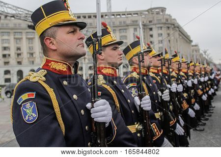 BUCHAREST ROMANIA - November 29 2015: Military are marching during a rehearsal for the National Day of Romania military parade in Bucharest. More than 3000 soldiers and personnel from security agencies take part in the massive parades on National Day of R