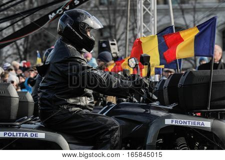 BUCHAREST ROMANIA DECEMBER 1 2015: Frontier policemen are marching for the National Day of Romania military parade in Bucharest. More than 3000 soldiers and personnel from security agencies take part in the massive parades on National Day of Romania.