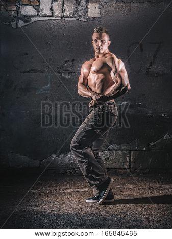 Bodybuilder Posing Over Grunge Wall