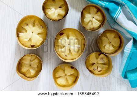 Preparation Of Traditional Easter Treats: Cakes, Raw Dough In The Baking Dish On A Wooden Table.