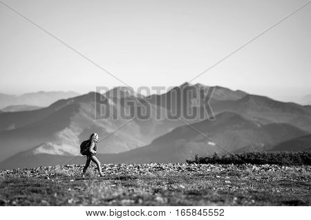 Tourists Is Walking On Mountain Plato With Backpack On