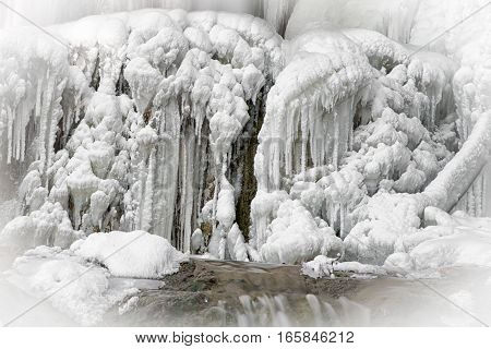 Big icicles on icefall during hard winter