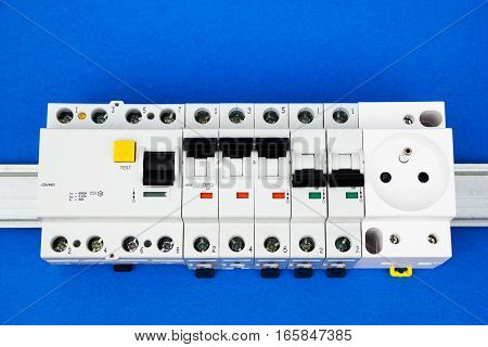 The residual-current device and circuit breaker on the blue background
