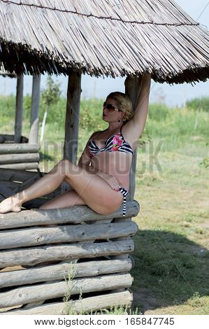 the woman sits on a wooden arbor in the summer in the resort a subject beautiful women sea tour the resort a holiday vacation