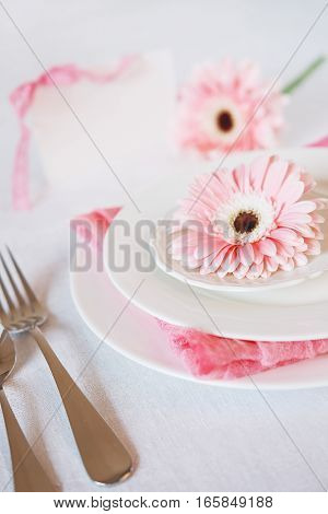 Valentine's Day pink decorated table setting for romantic dinner anniversary