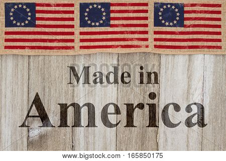 Made in America message USA patriotic old Betsy Ross flag and weathered wood background with text Made in America