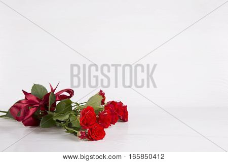 Bouquet Of Red Roses With Ribbon On White Background