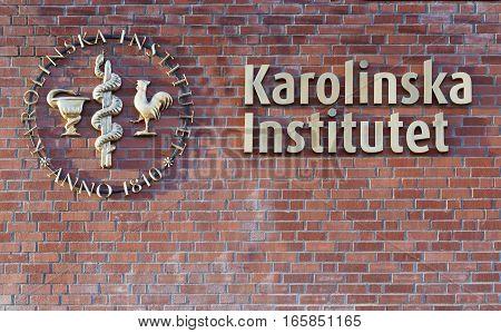 STOCKHOLM - JAN 15 2017: Logo of the hospital Karolinska institutet on a brick wall. January 15 2017 in Stockholm Sweden