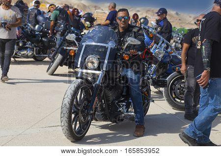 JERICHO ISRAEL - NOV 12 2016: One of the bikers of Israeli Harley Davidson biker club on his bike during a trip in Judean desert.