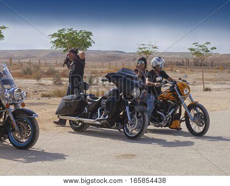 JERICHO ISRAEL - NOV 12 2016: Unidentified Israeli biker couple on the motorbike while on a trip in Judean desert.