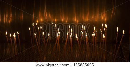 Church Candles Glowing In The Dark