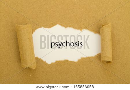 psychosis word written under torn paper .