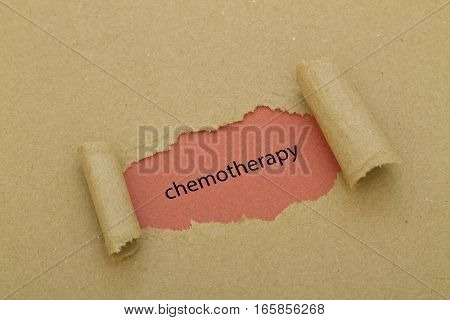 CHEMOTHERAPY word written under torn paper .