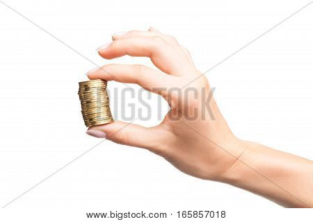 Female hand with stack of golden coins as hand OK sign isolated on white background