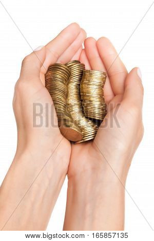 Female hand with stack of golden coins isolated on white background