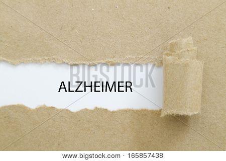 ALZHEIMER word written under torn paper .