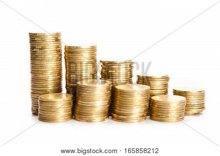 Stacks of golden coin close up isolated on a white background