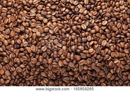 Roasted coffee beans background. Detailed close up