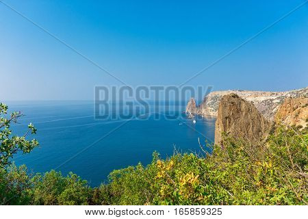 Beutiful landscape of blue sea with brown rocks