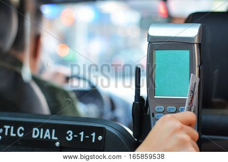 Close-up of a hand paying a taxi ride by credit card