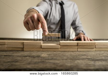 Completing A Brick Wall Business Concept