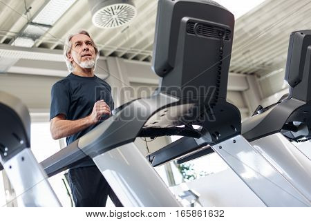 Senior Caucasian Man Working Out at the Gym