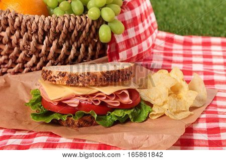Summer picnic basket ham and cheese sandwich