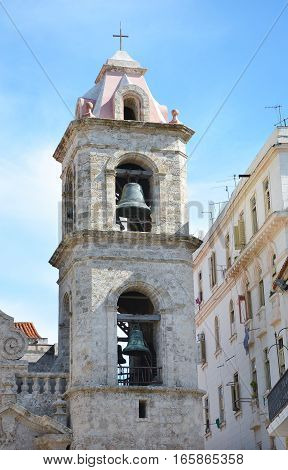 HAVANA CUBA - JULY 24 2016: The Bell Tower of the Cathedral of the Virgin Mary of the Immaculate Conception. In the Baroque style and made primarily of Coral blocks.