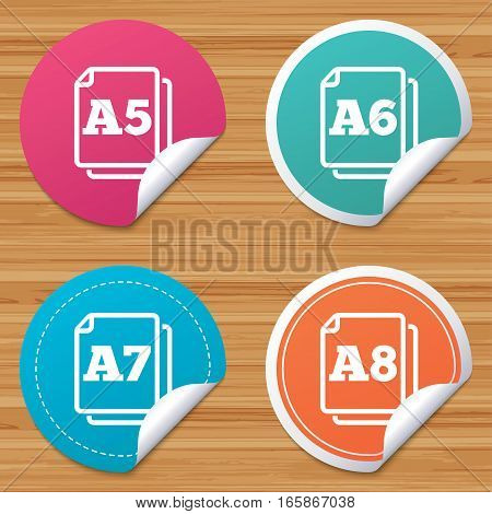 Round stickers or website banners. Paper size standard icons. Document symbols. A5, A6, A7 and A8 page signs. Circle badges with bended corner. Vector