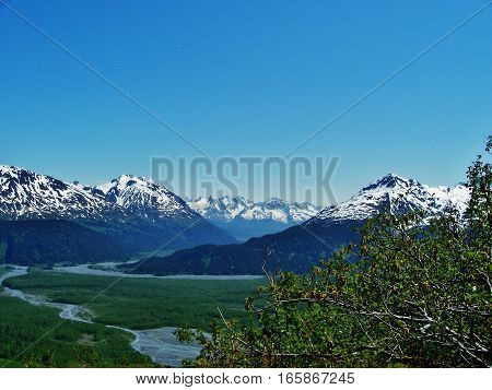 Majestic mountain view on a calm spring or summer day. Beautiful Alaska landscape with spring runoff from the mountains.