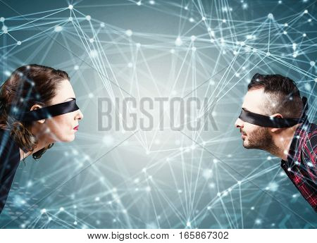 Woman and man blindfolded in a interconnection spheres connected each other. System of social network concept