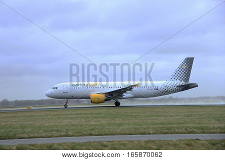 March 27th 2015 Amsterdam Schiphol Airport EC-KMI Vueling Airbus A320-216 Polderbaan Runway